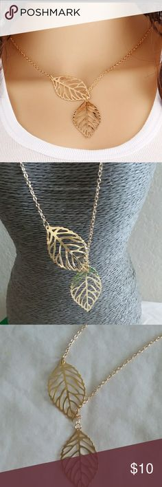 """2 leaf gold necklace 2 leaf gold necklace.  18"""" chain with 1.5"""" extender.  Leaves are 1.5"""" long.  Very lightweight,. New Jewelry Necklaces"""