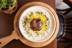 Photo              Roasted kholrabi in tzfat cheese, sesame seeds and thyme.                                      Credit             Sarit Goffen                      Everything served at Dok, from the rosé wine to the ice cream, is made from ingredients grown in Israel. O.K., almost... http://usa.swengen.com/tel-aviv-restaurant-with-local-ingredients-global-influences/