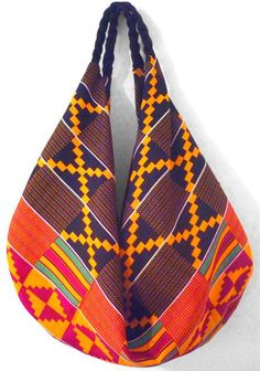 African Kente Bag The Ika Slouch Bag by HouseofRubi on Etsy African Inspired Fashion, African Print Fashion, Africa Fashion, African Accessories, African Jewelry, Fashion Accessories, Style Afro, Mode Wax, Ankara Bags