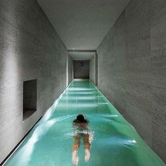 Long and narrow indoor pool in this Italian mansion