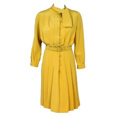 1965 Christian Dior Haute-Couture Chic Yellow Pleated-Silk Belted Dress | From a collection of rare vintage day dresses at http://www.1stdibs.com/fashion/clothing/day-dresses/