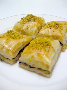 BAKLAVA WITH PISTACHIO My favorite baklava is this beauty. I posted the walnut version of baklava before. The only difference is t. Pistachio Baklava, Turkish Baklava, Turkish Recipes, Ethnic Recipes, Morrocan Food, Turkish Kitchen, Eastern Cuisine, Turkish Delight, Sweet Tooth