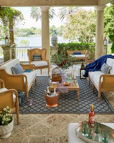 The perfect porch living room with our chic Calista Cane and Teak Collection outdoor furniture.