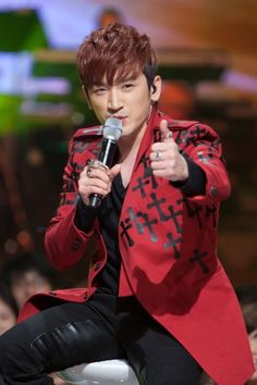Shinhwa's Lee Min Woo. That's right, I'm giving YOU a thumbs up ;)