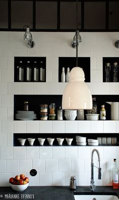 """Totally Tiled: 11 Kitchens with Unexpected Tile Details by Julie Carlson for Remodelista. """"Above: A white tiled wall with inset shelving painted black from French designer Marianne Evennou."""" (grouting and tiles, tiled kitchen shelves) Kitchen And Bath, New Kitchen, Kitchen Dining, Kitchen Decor, Minimal Kitchen, Kitchen Ideas, Kitchen Designs, Kitchen Tile, Ranch Kitchen"""