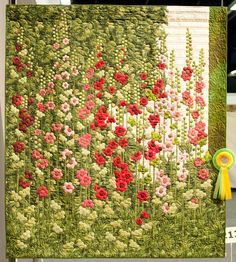 Hollyhock Quilt by Ans Schipper Vermeiren from the Netherlands. This one is called 'Stokrozen'. It won best of Show at the Open European Quilt Championships 2012 Flower Quilts, Landscape Quilts, Hexagon Quilt, English Paper Piecing, Pics Art, Applique Quilts, Fabric Art, Quilting Designs, Textile Art
