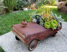 More Garden Containers You Never Thought Of… • Tons of Tips & Ideas! Love this repurposed old pedal car converted into a lovely planter!
