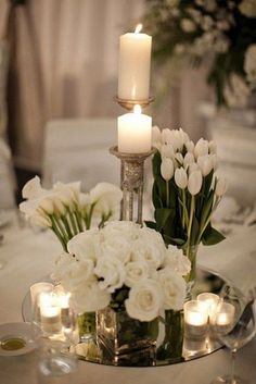 white spring wedding centerpiece / http://www.himisspuff.com/simple-elegant-all-white-wedding-color-ideas/