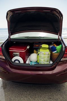 The Honda Civic's trunk is helpful when you're trying to keep your things organized on vacation.   Honda reminds you to properly secure items in the cargo area.