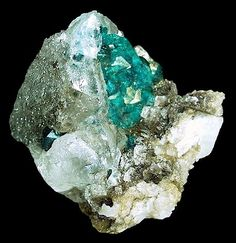 Dioptase crystals grown over by a transparent Calcite!  Both are on matrix with the Calcite surrounding the Emerald-green Dioptase!  From Altyn-Tyube, Karaganda Oblast', Kazakhstan.