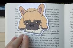 Zortus the Bulldog, he does not want to go to sleep without a bedtime reading :) Cute handmade magnetic bookmark.