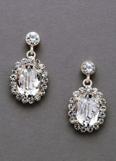 Be timeless in these lovely, large sparkling crystal earrings! Oleg Cassini Style 9050E at David's Bridal.