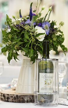 Gorgeous floral displays in jugs can look wonderful and surprisingly classy as wedding table centres.