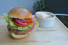 Chicken burgers with pickled onions, homemade buns, chipotle aioli