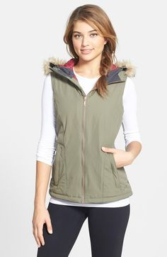 Free shipping and returns on Mountain Hardwear 'Potrero' Faux Fur Trim Hooded Vest at Nordstrom.com. From mountain lodge to downtown dining, stay warm, dry and on trend with this street-chic vest crafted from wind- and water-resistant AirShield fabric and filled with Thermal.Q synthetic insulation. Quilted side panels contour for a more feminine fit, and the faux-fur ruff around the zip-off hood can be removed for a whole new look.