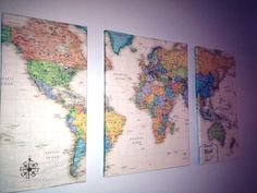 "Lay a world map over 3 canvas, cut into 3 pieces. Coat each canvas with Mod Podge and wrap the maps around them like presents. Let dry and hang on the wall about 2"" away from each other. Then add pins to all the places you've been."
