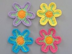 Lot of 12 Large Crochet Flower Appliques    Quantity: 12 (3 each of the colors shown in picture)    Material: cotton thread    Color: Fuchsia, Blue,