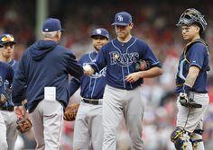 Column: Rays are best franchise in all of sports | Tampa Bay Rays manager Joe Maddon, left, takes the ball from starting pitcher Matt Moore, who heads to the dugout in the fifth inning in Game 1 of baseball's American League division series against the Boston Red Sox, Friday, Oct. 4, 2013, in Boston. (AP Photo/Michael Dwyer)