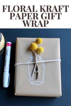 Simple kraft paper gift wrap with a marker and a fresh flower #diygiftwrap #kraftpaper #giftwrap #giftswrappingflowers