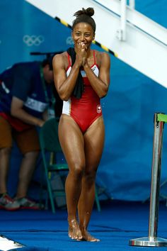 Jennifer Abel of Canada reacts the Women's Diving 3m Springboard Final on Day 9…