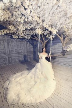 Wedding gown and white flowering tree with a swing // Pinned by Dauphine Magazine, curated by Castlefield (wedding invitation, branding, pattern designs: www.castlefield.co). International Couture Fashion/Luxury Wedding Crossover Magazine - Issue 2 now on newsstands! www.dauphinemagazine.com. Instagram: @ dauphinemagazine / @ castlefieldco. Dauphine and Castlefield only claim credit for own images.
