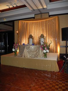 a sweetheart table done with traditional indian wedding staging and backdrop. bling bling!