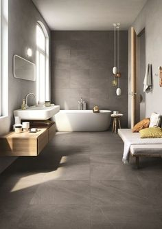 Badezimmer in Grau mit weißem Waschbecken und Badewanne inklusive Sitzband, Home Spa, Wellness, Badezimmer, Bathtub, Baden, Beauty, Hängeleuchten,