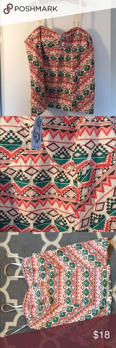 """NWT Torrid Aztec Pink Teal Bodice Sz 3 New with tags! Women's Aztec print Bodice halter top in size 3. 97% cotton 3% spandex. Lining is 100% polyester. Armpit to armpit is 21"""". Top of shoulder to bottom of shirt is 27.5"""". torrid Tops"""