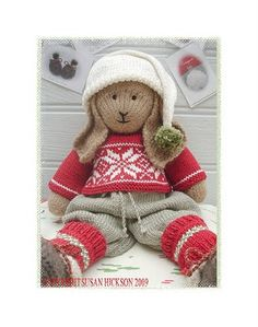 Bo Rabbit from Mary Jane's Tearoom.  His shoes are on my knitting needles.