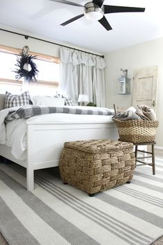 I designed my master bedroom decor off of this grey striped rug from RugsUSA. It's the perfect mixture of calming neutrals and a fresh coastal cottage feel.