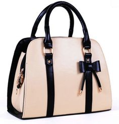 This bag is so gosh darn cute!! Structured, bowler bag, with bow detail and black trim. Comes in 5 colors. $26.10
