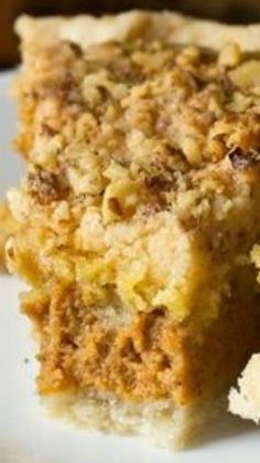 Pumpkin Crumb Pie Recipe ~ It has 4 basic layers: The pie crust, pumpkin mixture, the cake mix, and the butter and nuts.