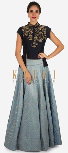 Buy Online from the link below. We ship worldwide Click Anywhere to Tag Bluish grey skirt with navy blue blouse enhanced in moti and cut dana embroidery work only on Kalki  Featuring skirt in blush grey in brocade silk. Matched with waist length blouse in raw silk. Enhanced in zardosi embroidery along with neckline and armhole. It comes with front opening in zip along with front side slits. It comes with standing collar and cap sleeve. Slight variation in color is possible.