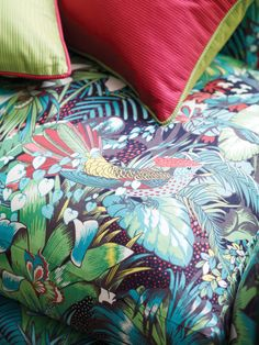 Matthew Williamson presents a collection of exotic fabrics and co-ordinating wallpapers inspired by an island paradise. A close up of a couch upholstered with Matthew Williamson's Jungle Beat print. Tropical Upholstery Fabric, Tropical Fabric, Matthew Williamson, Osborne And Little, Home Furnishing Stores, Textiles, Jungle Print, Mid Century Modern Furniture, Fabric Wallpaper