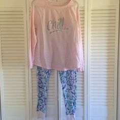 Pajama set Super cute and cozy! It's a baby pink top that says chill on it in silver glitter. The pants have a white, blue, pink, and teal pattern. Very stretchy! Marked as XL. Fits me at 18/20. Xhilaration Intimates & Sleepwear Pajamas