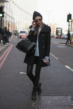 London Calling: 102 of the Chicest Street Snaps From LFW: Slick leather and biker boots got a warm Winter complement from this showgoer's military-style coat.