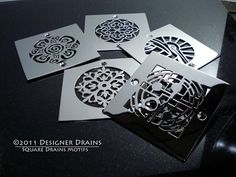 Designer Drains - Square Drains  I finally had some time to make some our designs into square motifs. Some of the drains I redesigned to fit the square format. All are made from polished stainless steel. more»