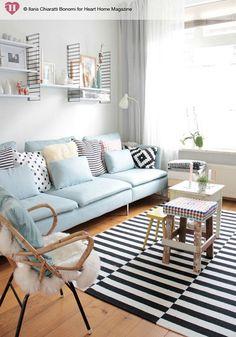 Get your home ready for spring with this pastel decor inspiration! Fill your flat with a soft colour scheme, a blue pastel couch, patterned accent pillows, and a bold rug for a modern yet shabby chic look.