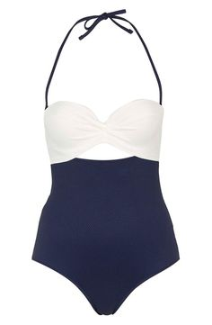 Navy and white color blocking adds to the vintage vibe of a one-piece swimsuit from Topshop. It features an underwire bandeau top, flirty cutouts and a removable halter strap for a line-free tan.