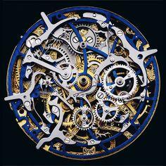 Opened watch showing mechanical movement - Gérald Genta, chronographe mono poussoir quantième perpétuel - photography by Guido Mocafico, Edition of 7+ 2 AP