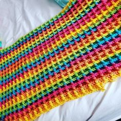 Waffle stitch is amazing and I recommend it to all crochet lovers! Rainbow yarns are widely available in online stores and many crocheters use them for blankets. Amanda is no exception and you can see her lovely waffle blanket in the photo below. If the yarn is dyed nicely, color changes in the middle of the row should not be a problem – I'm sure it doesn't bother me in this case! #freecrochetpattern #crochetpattern #wafflestitch #wafflestitchblanket