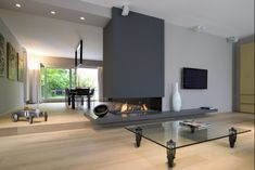 Our Living Room / Dining Room fireplace divider Home Fireplace, Modern Fireplace, Fireplace Design, Fireplaces, Home Living Room, Interior Design Living Room, Living Room Designs, Living Room Decor, Dining Room