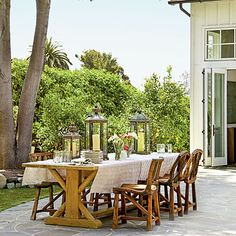 Teak furnishings and Moroccan-style lanterns make this Malibu patio perfect for dining al fresco. | Coastalliving.com