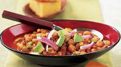 This chili showcases ingredients that early explorers discovered in the New World—pinto beans, corn, tomatoes, and lima beans. Sprinkle diced avocado and chopped red onion on top for a flavorful garnish. If you don't have a slow cooker, this recipe is still very easy. For stovetop prep, all of the ingredients except the avocado and red onions go into the pot at once, then everything simmers for about 2 hours.