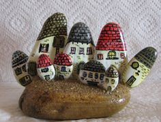 House (Home) Rock Paperweight - I am thinking make a smaller version and use clay for part of it such as the houses to make it lighter. Add flowers and make it summery