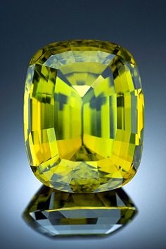Chrysoberyl is composed of beryllium aluminum oxide and is colorless when in its pure form. Trace amounts of iron color the mineral yellow (as seen here), brown, and green. Chrysoberyl is an extremely hard and durable mineral. It is most commonly found as greenish-yellow crystals. Although better known for the rare and valuable cat's eye and alexandrite varieties, chrysoberyl is also cut into such attractive gems as this 114.25 carat stone from Minas Gerais, Brazil.