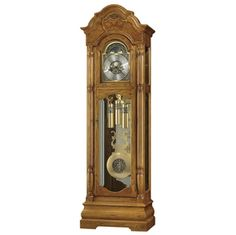 Howard miller Traditional Oak grandfather floor clock SCARBOROGH611144 Special 82nd Anniversary Edition grandfather clock features a distinct bonnet pediment with book-matched olive ash burl overlays and a decorative carved applique. Brushed satin brass finished dial features cast center and corner ornaments, and a moon arch with an astrological blue moon phase.