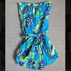 Lilly Pulitzer Colleen Romper Only worn a couple of times! The loop to tie the belt around is broken but can be easily sewed back and the belt still fits well even if not fixed. Other than that it is in good condition. Lilly Pulitzer Dresses