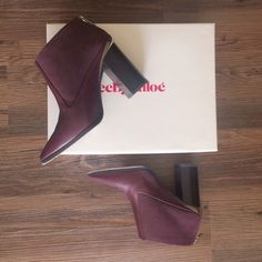 HPSee by Chloe booties Dark plum/wine pointy-toe See by Chloe booties. Pre-loved but in excellent condition; I'm SO sad to part with these but they are a bit too snug for me  as I'm a pretty true 6. Tiny black scuff on the silver hardware as pictured above (circled in red). See by Chloe Shoes Ankle Boots & Booties