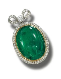 EMERALD AND DIAMOND PENDANT, CIRCA 1900.  The emerald cabochon bordered by millegrain-set single- and circular-cut diamonds, suspended from a similarly set ribbon-bow surmount